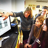 BRYAN EATON/Staff photo. Amesbury Middle School science teacher Gale Regis shows students in groups the jump in seismic waves from the school's seismometer which recorded the earthquake about six miles northeast of the city near East Kingston, N.H. on Thursday morning. From, from left, Isabelle Penny and Ella Pothier, and back, Natalie Ward and Ava Maurer, all 12. Earthquakes are part of the students curriculum and they build their own seismometers for testing each spring.