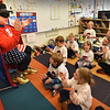 BRYAN EATON/Staff photo. Zero the Hero counts to 100 by 10's with kindergartners in each class, here, Sherry Herzig's, after arriving to the Bresnahan School by police escort for the 100th day of school. The caped math super hero goes to each kindergarten class once a week to get students excited about numbers. Zero, a.k.a. Rob Ouellette, is hanging up his cape after 16 years or volunteering his time in the role.