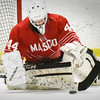 BRYAN EATON/Staff photo. Masconomet goalie Molly Elmore stops a shot on net.