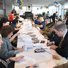 BRYAN EATON/Staff photo. Area emergency personnel, politicians, community members, active and retired military converged at Amesbury Chevrolet to write Valentine cards for area veterans who live at home and those who are in VA hospitals, part of the Heart to Heart program.