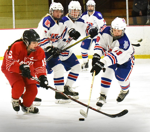 BRYAN EATON/Staff photo. Masconomet's Samantha Kelleher and Methuen's Abby O'Keefe battle for control/