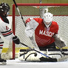 BRYAN EATON/Staff photo. Goalie Molly Elmore makes a save on a Winchester shot on net.