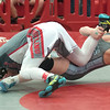JIM VAIKNORAS/Staff photo Josh Stevens of Triton wrestles Mike Yirrell of Wakefield at the D3 State Tournament at Wakefield High Saturday.