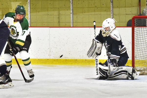 BRYAN EATON/Staff photo. Pentucket forward RIchie Hardy shoots on net but Hamilton-Wenham goalie Finn Brophy deflects the puck.