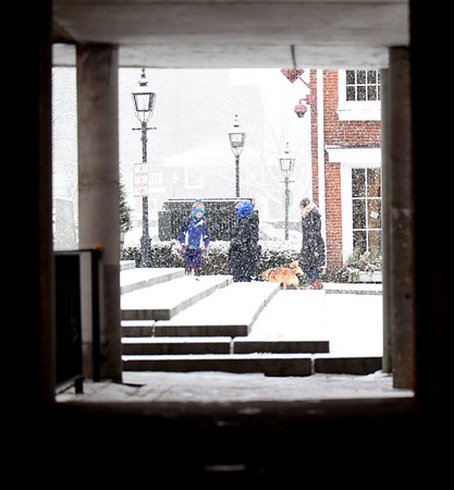 BRYAN EATON/Staff photo. Fluffy snow falls on Inn Street in Newburyport early Wednesday afternoon. The snow is forecast to turn to rain sometime near the evening commute.