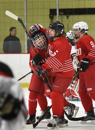BRYAN EATON/Staff photo. Mikayla Vincent gets a hug from her teammates as she scored their second goal of the game.