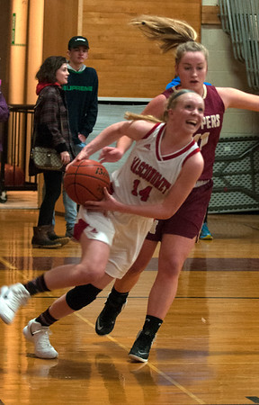 JIM VAIKNORAS/Staff photo Masconomet's Marissa DeLucia drives to the basket at home against Newburyport Friday night.