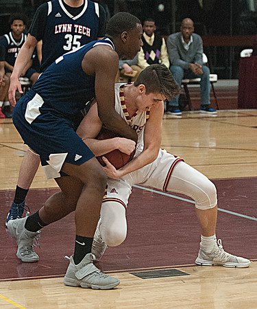 JIM VAIKNORAS/Staff photo Newburyport's Bretton Ross fights for the ball with against Lynn Tech's Marcus Taylor at Newburyport Tuesday night.
