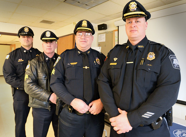 BRYAN EATON/Staff photo. Assisting Newburyport Police Lt. Matthew Simons, right, were, from left, Groveland Detective Steven Petrone, Sgt. Eric Gorski and Georgetown Sgt. Kevin DeFeo.