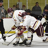 BRYAN EATON/Staff photo. Clippers' Dylan Rogers and Francis Kearney IV go for a loose puck.