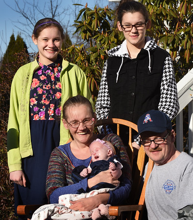 BRYAN EATON/Staff photo. Sajjona Murphy, 4 months, has Trisomy 18, a rare genetic disorder, surounded by her parents, Heidi and Kenny, and sisters Sayge, 13, left, and Kelseigh, 15.