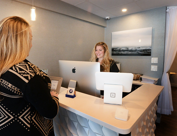BRYAN EATON/Staff photo. Haley Pratt, right, checks in a customer at Blue Water Wellness, which is a healing place for the <br /> mind and body.
