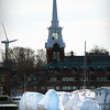 BRYAN EATON/Staff photo. Afternoon sun shines on these boats covered with shrinkwrap on Newburyport's waterfront in a view from Salisbury. With temperatures in the 50's this week and March beginning on Thursday, it won't be long before the boats and docks get moved back into the Merrimack River.