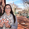 BRYAN EATON/Staff photo. Kassandra Gover, executive director of the Amesbury Chamber of Commerce, with tickets to remind people to vote for the town in the Small Business Revolution in which Amesbury has been named one of five finalists.