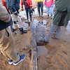 BRYAN EATON/Staff photo. Local historian Ghlee Woodworth came across the apparent remains of an old ship while jogging along Plum Island beach just north of the south jetty of the Merrimack River. She contacted Graham McKay, executive director and master boatbuilder at Lowell's Boat Shop, center, in Amesbury to take a look. He visited the spot with some teenage apprentices to give them a look as part of their greater education of nautical vessels. He figures it's part of the deadwood stern structure from a 30-50 foot craft, likely from the latter half of the nineteenth century and either a small fishing boat, harbor craft or coastal craft.