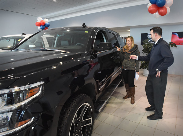 BRYAN EATON/Staff photo. Amesbury Chevrolet sales consultant Chris Gibbons shows off a Tahor to Kasie Kinney repeat customer Kasie Kinnney of Wells, Maine.