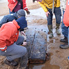 BRYAN EATON/Staff photo. Local historian Ghlee Woodworth came across the apparent remains of an old ship while jogging along Plum Island beach just north of the south jetty of the Merrimack River. She contacted Graham McKay, executive director and master boatbuilder at Lowell's Boat Shop, right, in Amesbury to take a look. He visited the spot with some teenage apprentices to give them a look as part of their greater education of nautical vessels. He figures it's part of the deadwood stern structure from a 30-50 foot craft, likely from the latter half of the nineteenth century and either a small fishing boat, harbor craft or coastal craft.