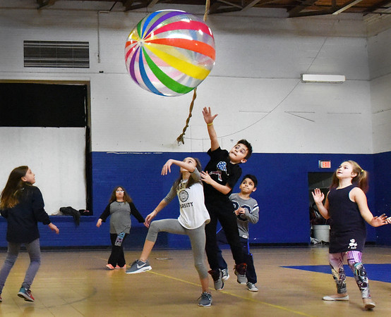 BRYAN EATON/Staff photo. Youngsters play a round of giant volleyball at the Boys and Girls Club on Monday afternoon with the finals to be played on Friday. The club is open this vacation week with special activities each day.