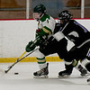 JIM VAIKNORAS/Staff photo Pentucket's Jack Queenan protects the puck from Marshwood/Noble player Ray Horne Wednesday night at the Graf Rink in Newburyport.