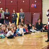 "BRYAN EATON/Staff photo. David Christian, an Olympic gold medalist from the 1980 USA hockey team, spoke to students at the Bresnahan School in Newburyport on Friday morning. He did a presentation about the history of the Olympics in general, and donated a signed copy of ""Z is for Zamboni"" a book about hockey that talks a little bit about their gold medal win."