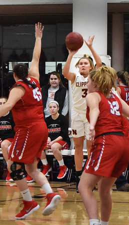 BRYAN EATON/Staff photo. Maggie Pons shoots over Tewksbury defenders.