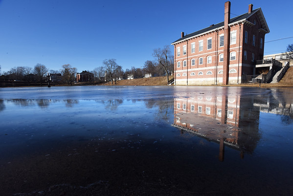 BRYAN EATON/Staff photo. The Newburyport Superior Courthouse is reflected in the melting ice in the Frog Pond signaling that it's likely not a good idea to go onto the ice. More melting should occur Thursday as the temperature is forecast to reach over 50 degrees.