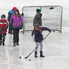 JIM VAIKNORAS/Staff photo Kids play hockey at the annual West Newbury Winter carnival at Mill Pond Saturday.