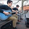 BRYAN EATON/Staff photo. Dylan Merrill, left, and Jack Frithsen, both of Rowley, play their guitars for tips on their first foray performing in Newburyport's Market Square on Wednesday afternoon. The two, who favor rock music, are hoping to start a band as soon as they find a suitable bass player.