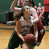 JIM VAIKNORAS/Staff photo Pentucket's Sarah Kern is fouled as she drives to the basket against Mascomonet Friday night at Pentucket.