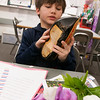 JIM VAIKNORAS/Staff photo Brayson Brown used a wooden shoe and tulips in his presentation of his Dutch heritage at the Salisbury Elementary School 2nd grade Passport to Learning Friday afternoon. Each 2nd grader at the school made a display and gave a short presentation about their ethnic heritage.