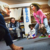 BRYAN EATON/Staff photo. Lisa Hutchings, rear, left,  of Audubon's Joppa Flats Education Center brought the program Paws and Claws to the Newburyport Montessori School on Wednesday morning. Abigail Lawler, 4, jumps toward volunteer Susan Coolidge showing how rabbits jump  their rears paws landing in front of their front paws.