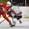 BRYAN EATON/Staff photo. Masconomet defenseman Anna Behringer gets a shot past a Winchester player.