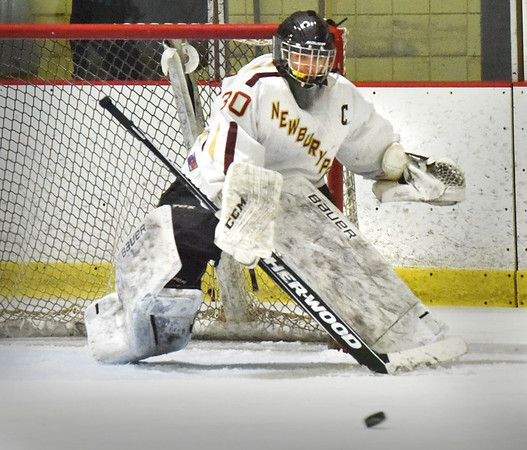 BRYAN EATON/Staff photo. Kenneth Hodge is ready as a shot on net flies past.