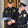 BRYAN EATON/Staff photo. Newburyport Police Lt. Matthew Simons, left, is read a citation by Groveland Police Chief Jeffrey Gillen. Simons was off duty last month and came across an accident due to a medical condition in which he performed CPR on the victim.