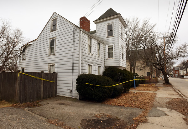 BRYAN EATON/Staff photo. A portion of this house at 320 Merrimac Street in Newburyport, at left, collapsed on Wednesday night.