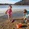 BRYAN EATON/Staff photo. The fact that Lake Gardner in Amesbury is mostly covered in ice seems to be lost on Laura Lindenmayer, 4, left, and her brother Pax, 6, who were having a grand time playing on the beach. Their mother Ellie was thinking about going to Salisbury Beach, but they like Lake Gardner.
