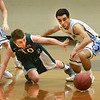 BRYAN EATON/Staff photo. The Hornets' Kellen Furse and Triton's Jack Tummino go for a loose ball.