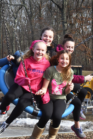 BRYAN EATON/Staff photo. Sixth-graders have fun on a giant swing at Newbury Elementary School at recess on Monday afternoon. Clockwise, from left, are, Aby Joyner, 12, Josie Robertson, 11, Nola Bowes, 12, and Alle Scipione, 12.