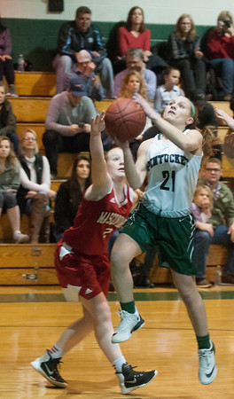 JIM VAIKNORAS/Staff photo Pentucket's Maddie Doyle drives to the basket against Mascomonet Friday night at Pentucket.
