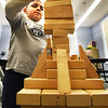 BRYAN EATON/Staff photo. Larry Greene, 10, of Amesbury builds a tower that he said he would knock down when complete on Tuesday afternoon. He and several others were building different structures from blocks in the game room at the Boys and Girls Club in Salisbury.