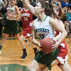 JIM VAIKNORAS/Staff photo Pentucket's Casey Hunt looks to pass against Mascomonet Friday night at Pentucket.