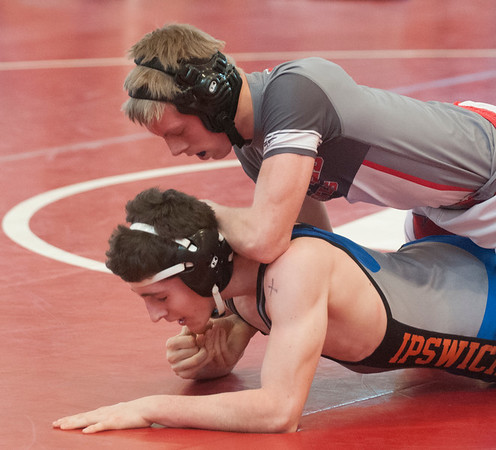 JIM VAIKNORAS/Staff photo Georgetown-Ipwich's Connor Young wrestles Brock Johnson at the D# sectionals at Melrose High School Friday.