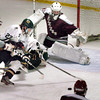 Newburyport: Pentucket's Ben Klosowski falls short of a goal as Rockport goalie Chris Gregory defends his net. Bryan Eaton/Staff Photo