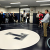 Byfield: Triton wrestling coach Shawn McElligott gives a tour of the renovated practice room which includes new wall and floor mats and painting of the ceiling. Bryan Eaton/Staff Photo