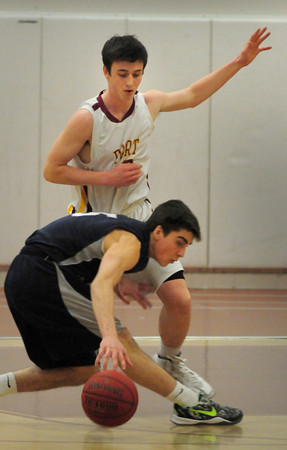 Newburyport: Newburyport's Dan Baribeault covers Hamilton-Wenham's Nikos Lara as he almost loses control of the ball. Bryan Eaton/Staff Photo