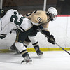 Newburyport: Pentucket's Ben Klosowski checks Haverhill's Jack Gorman during their game at the Graf Rink in Newburyport Friday night. Jim Vaiknoras/staff photo