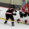 Newburyport: Amesbury's Andrew Reidy flips the puck past Marblehead's Cam McDonald during the Newburyport Bank 19 Annual Hockey Classic. Amesbury won the game in a shootout. Jim Vaiknoras/staff photo