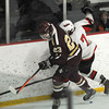 Stoneham: Newburyport's Matthew Kelleher fights for the puck with  Winchester's Danny Marx during their game at Stoneham Arena. JIm Vaiknoras/staff photo
