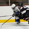 JIM VAIKNORAS/Staff photo HPHA's Rebecca Harty races for the puck against Lynnfield at Veteran's Rink in Haverhill.