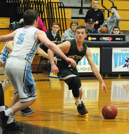 JIM VAIKNORAS/Staff photo Pentucket's NGus Flaherty drives to the basket at Triton Friday night.